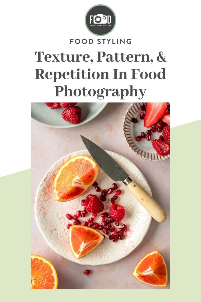 "Orange slices, pomegranate seeds, raspberries, and strawberries with a knife on textured plates on a light, marbled surface. Text over the image states, ""Texture, Pattern, and Repetition in Food Photography."" Photograph by Lauren Caris Short of Food Photography Academy."