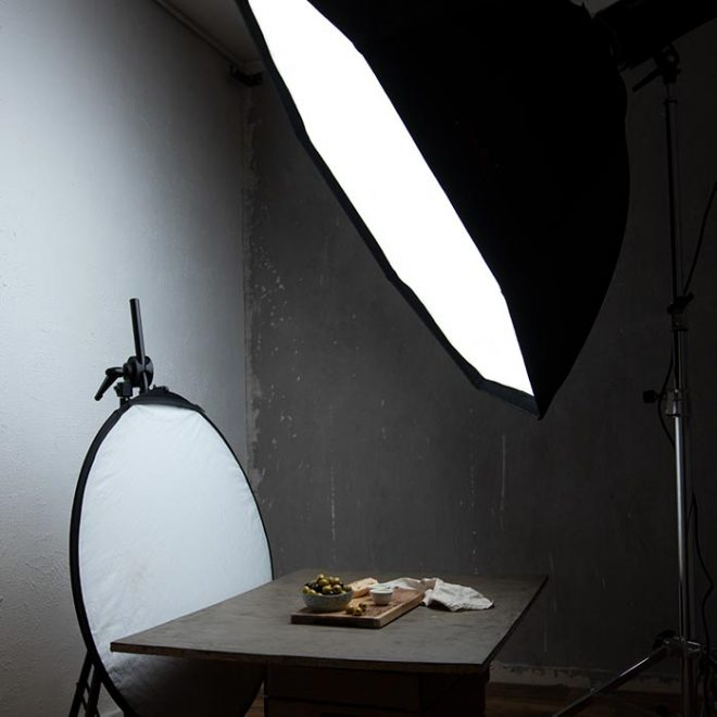 a light box and reflector are set up in a studio