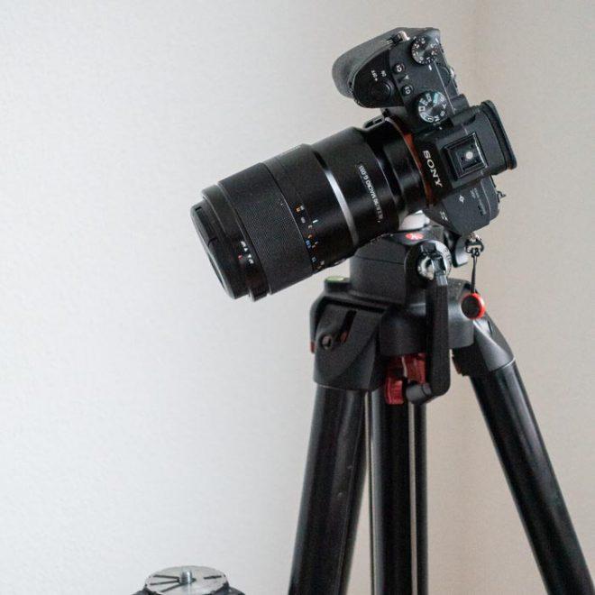 A camera sits atop a tripod