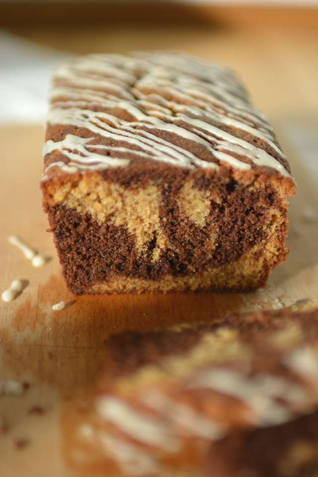 An image of ginger cake with clunky composition as an example of a common beginner food photography mistake. Example by Lauren Short of Food Photography Academy.