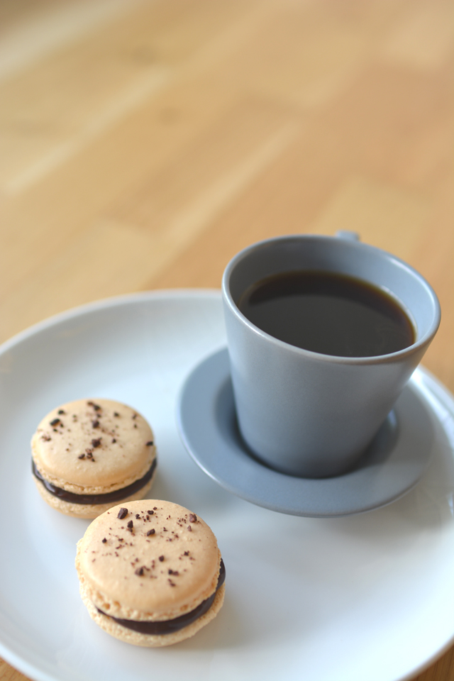 An image of coffee and some macaroons that was shot using the wrong lens as an example of a common beginner food photography mistake. Example by Lauren Short of Food Photography Academy.