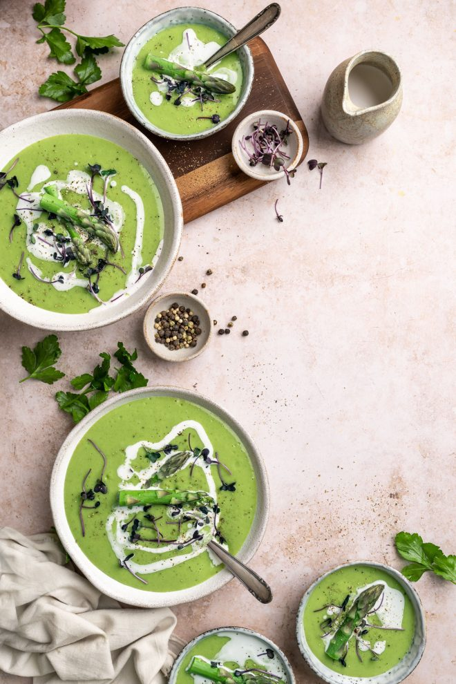 A flatlay image of green curry composed using the C-shape by Lauren Short from Food Photography Academy.