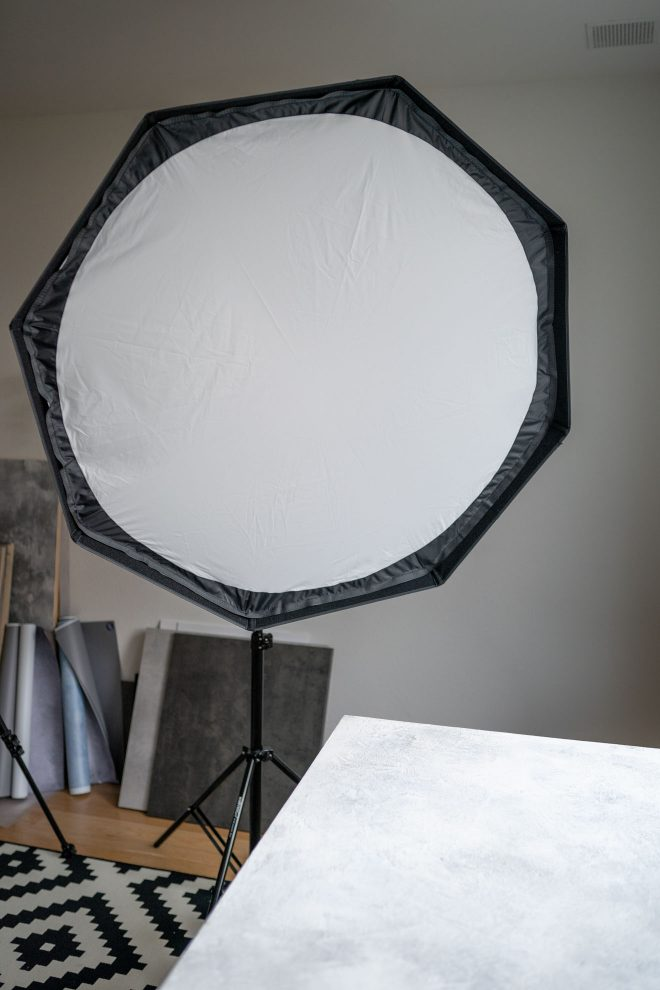 A softbox on a lightstand in a home food photography studio, photograph by Lauren Caris Short of Food Photography Academy