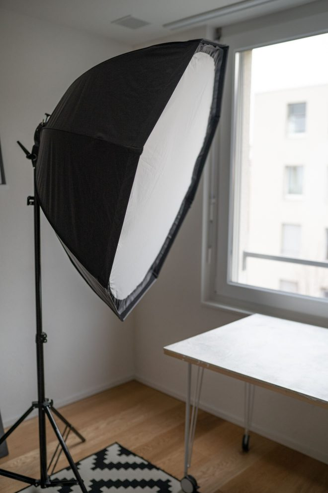 A giant softbox on a lightstand in the middle of a home photography studio, photograph by Lauren Caris Short of Food Photography Academy