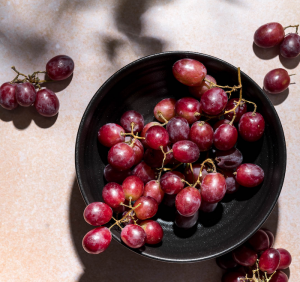 A bowl of grapes photographed with gobo lighting
